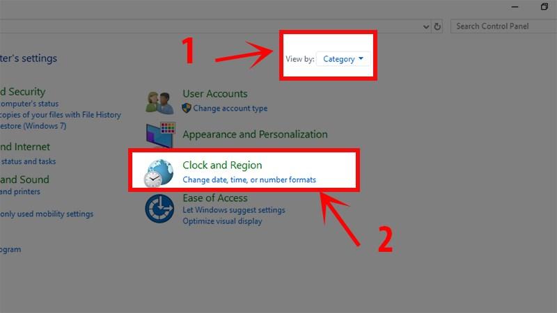 Trong của sổ Control Panel, chọn phần Category ở góc trên bên phải sau đó chọn dòngChange date, time, or number formats.